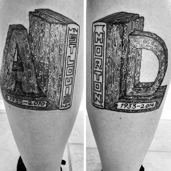 Typical wooden like memorial tattoo on legs with lettering
