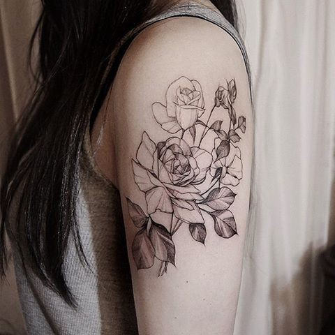 Typical Zihwa blackwork style shoulder tattoo of impressive roses