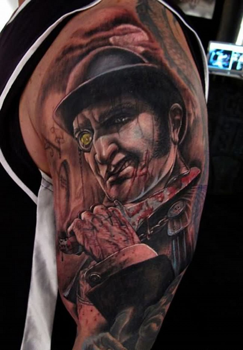 Unbelievable big detailed looking shoulder tattoo of terrifying maniac with bloody knife