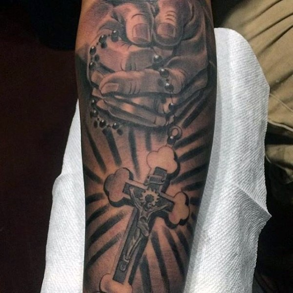 Unbelievable black and gray style praying hands tattoo on forearm combined with cross
