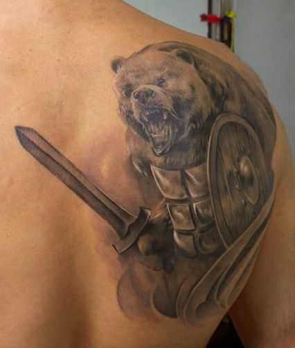 Unbelievable black and white shoulder tattoo of big bear with armor, shield and sword