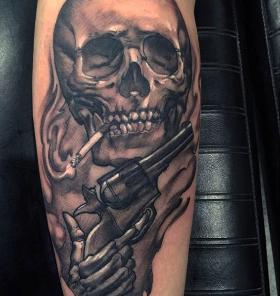Unbelievable colored smoking human skull tattoo on forearm combined with old revolver