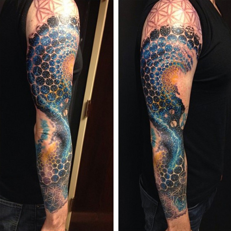 Unbelievable designed and painted multicolored space tattoo on sleeve