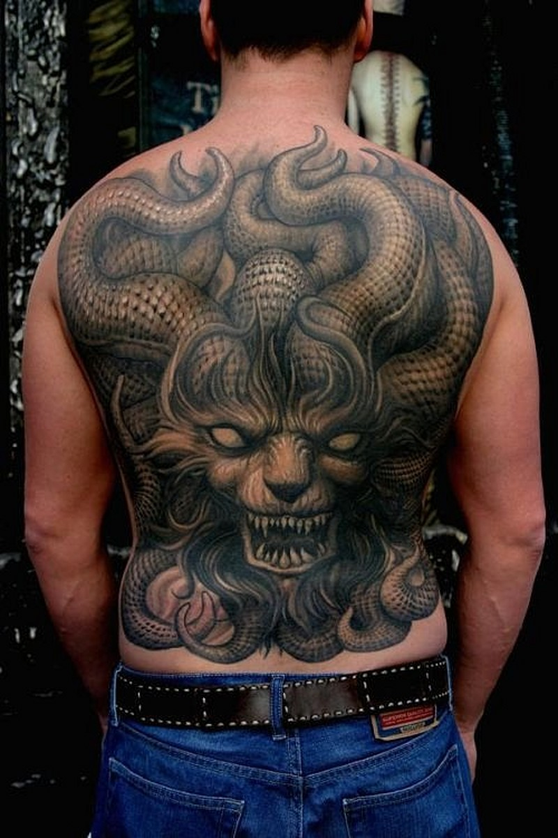 Unbelievable detailed 3D like massive whole back tattoo of evil evils face with horns