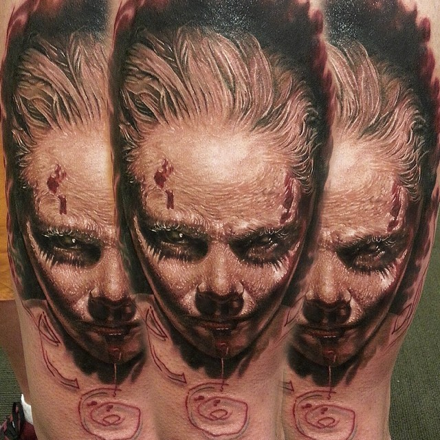 Unbelievable painted horrifying colored evil witch girl tattoo on arm