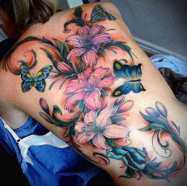 Unbelievable painted realistic looking colored floral tattoo with butterflies on whole back
