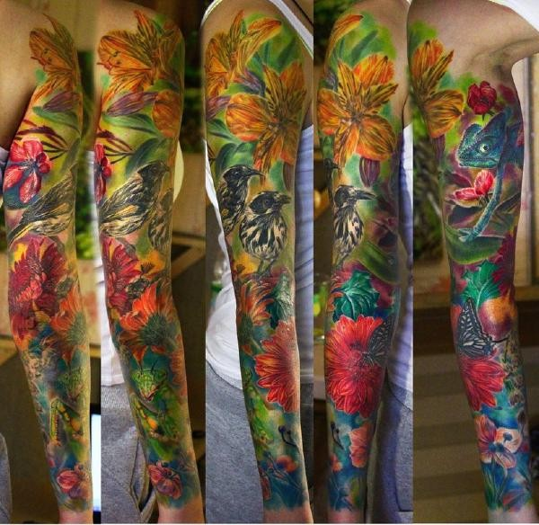 Unbelievable realism style colored large sleeve tattoo of various flowers with birds and butterflies