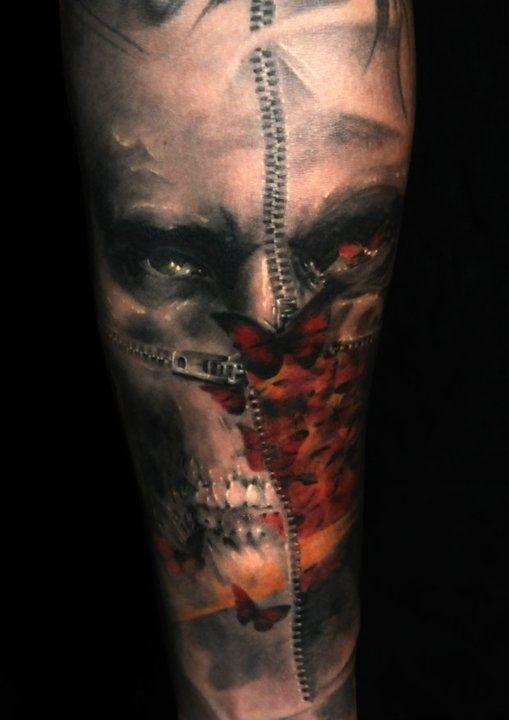Uncanny half of skull half of face tattoo