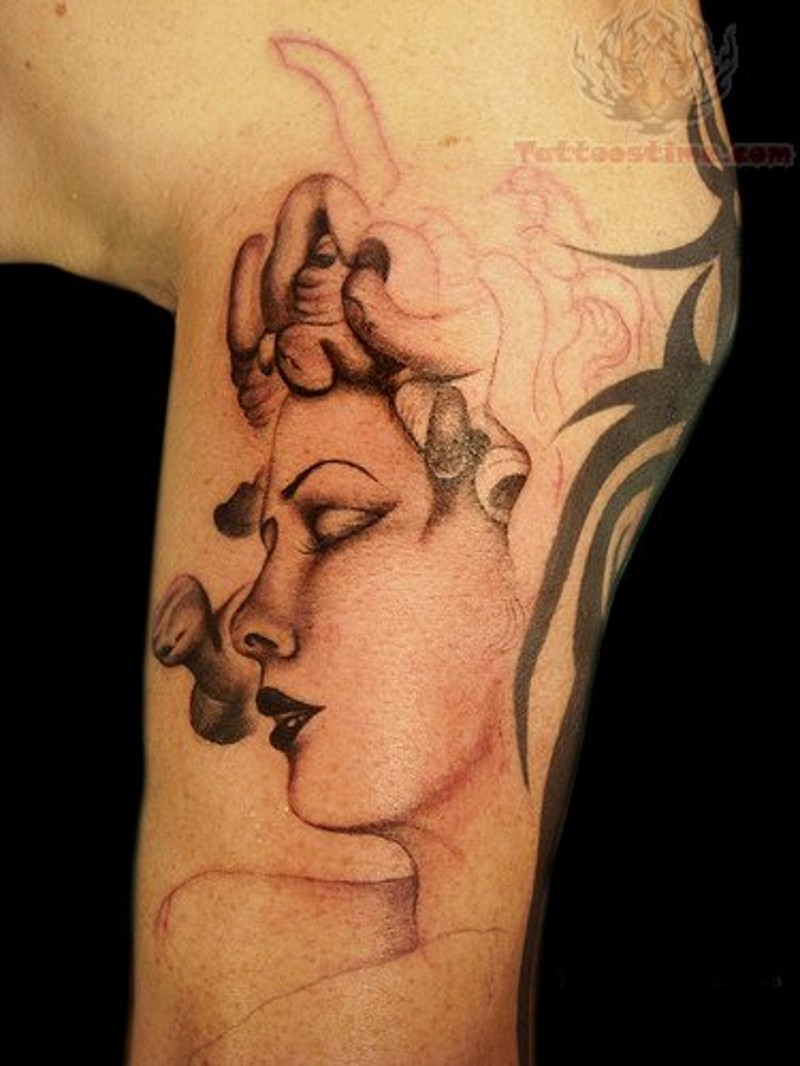 Unfinished beautiful looking arm tattoo of Medusa head