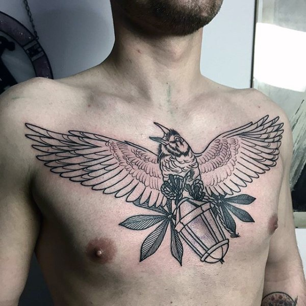 Unfinished black ink chest tattoo of big bird with old lighter