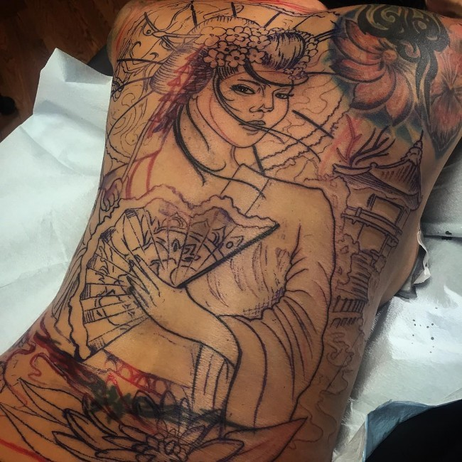 Unfinished half colored detailed beautiful geisha tattoo on whole back with fan