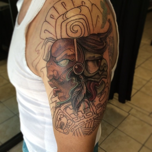Unfinished half colored shoulder tattoo of ancient wizard