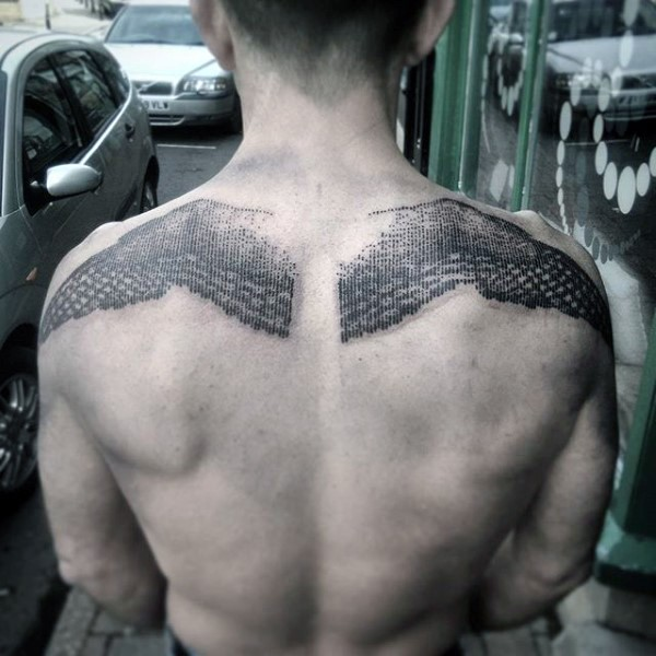 Unique black ink engraving style upper back tattoo of eagle wings