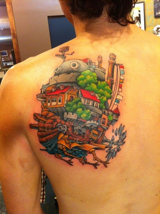 Unique colored funny cartoon style upper back tattoo of fantasy flying house-ship