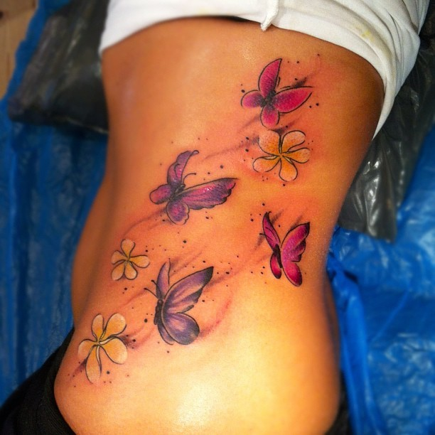 Unique cute butterfly tattoos on rib side