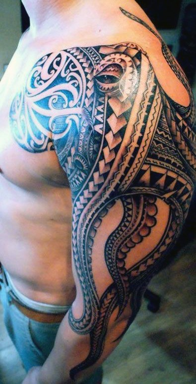 Unique designed big octopus tattoo on shoulder stylized with tribal ornaments