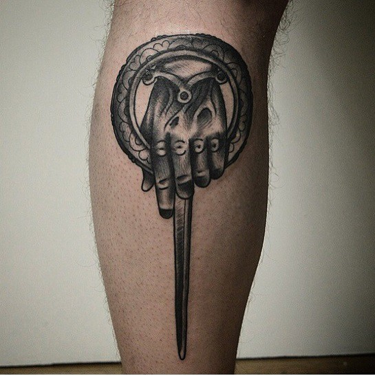 Unique designed black and white let tattoo of fantasy sword
