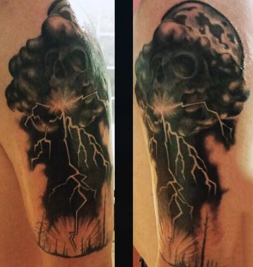 Unique designed black and white skull shaped storm cloud with lightning tattoo on arm
