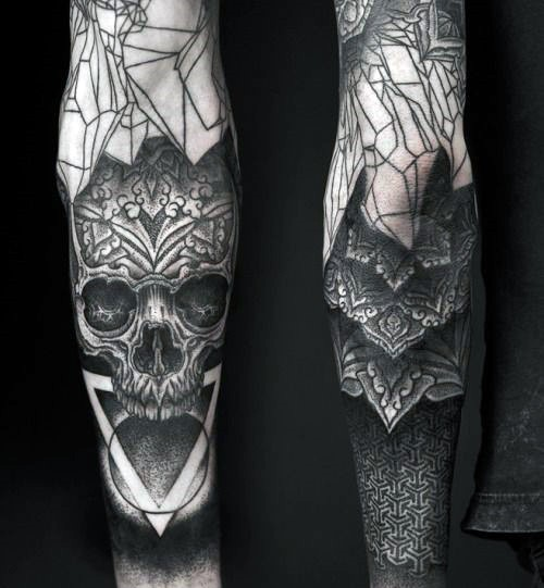 Unique designed black ink skull with flower stylized by ornaments tattoo on sleeve