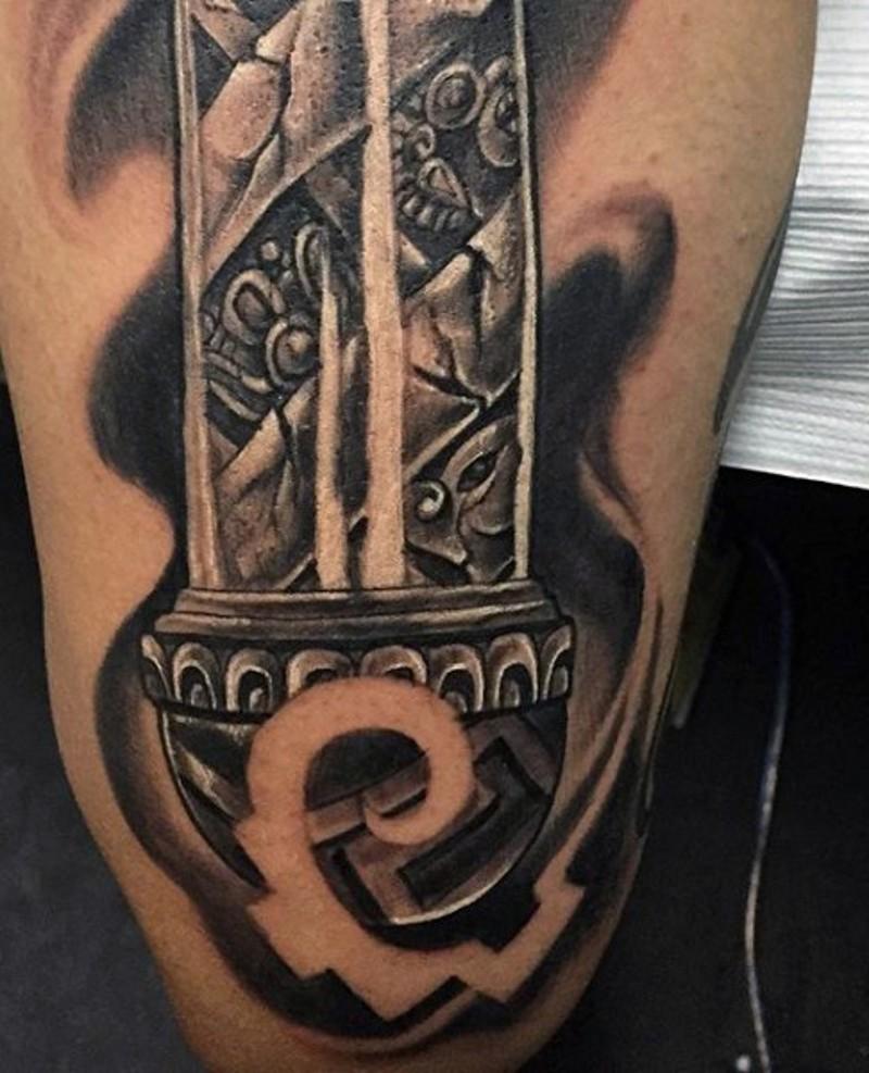 Unique designed black ink tribal statue tattoo