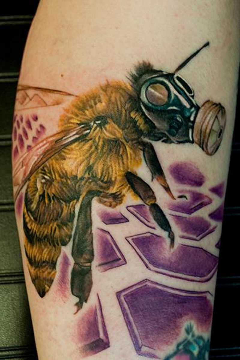 Unique designed colored arm tattoo of bee in gas mask