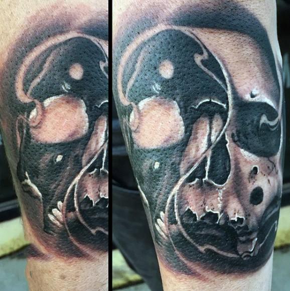 Unique designed Yin Yang symbol shaped human skull tattoo