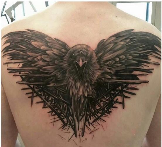 Unique massive black ink detailed upper back tattoo of fantasy crow