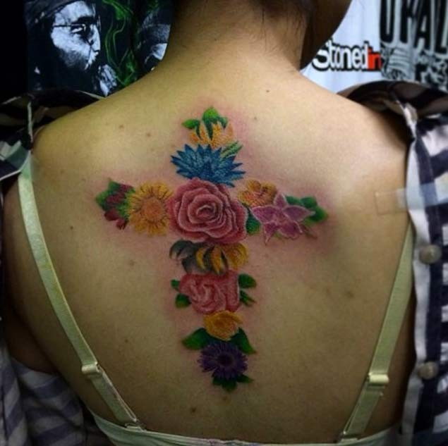 Unique multicolored big cross shaped on back tattoo of flowers