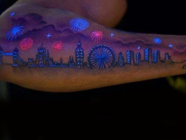 Unique painted and colored glowing ink night city tattoo on sleeve