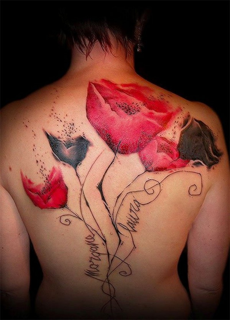 Unique painted big flower shaped colored tattoo with lettering on back