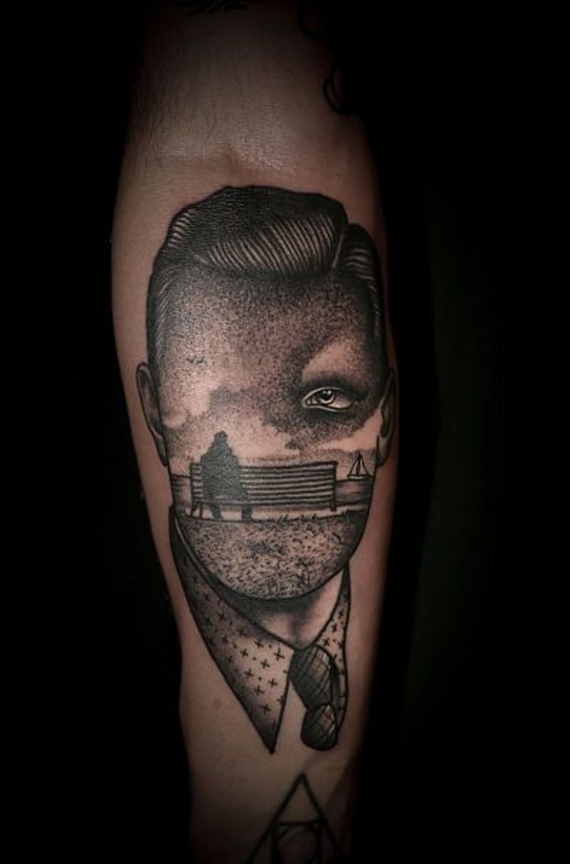 Unknown style painted black and white faceless portrait tattoo on arm