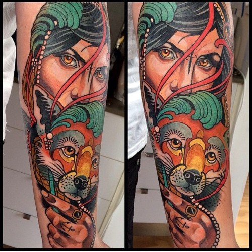 Illustrative style colored arm tattoo of woman with fantasy fox and jewelry