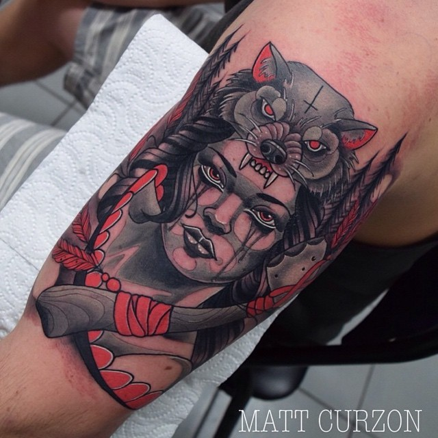 New school style colored shoulder tattoo of beautiful woman with axes and wolf helmet