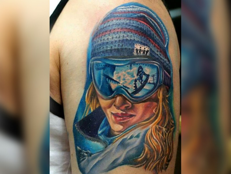 New school style colored shoulder tattoo of snowboarder woman