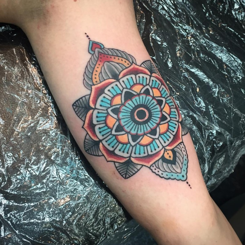 New school style colored arm tattoo of big ornamental flower