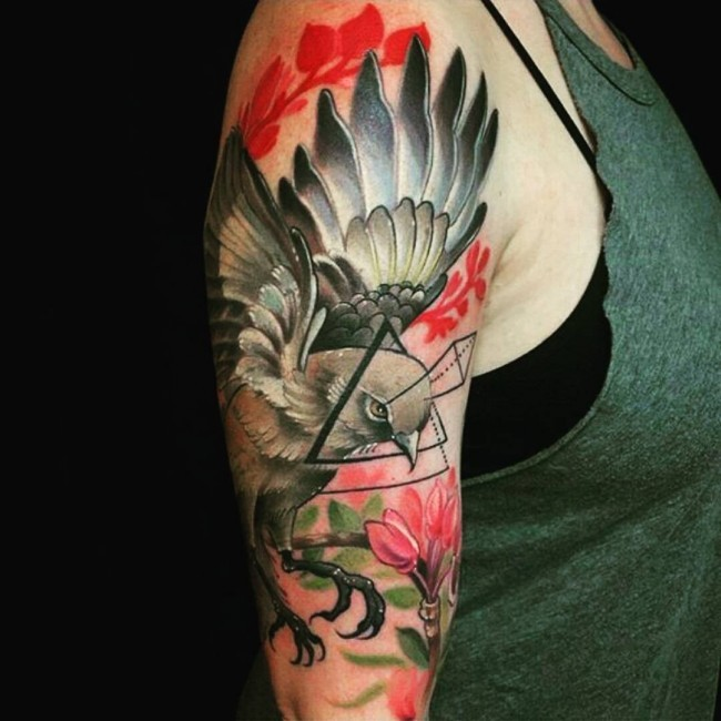 New school style colored shoulder tattoo of flying bird with triangle