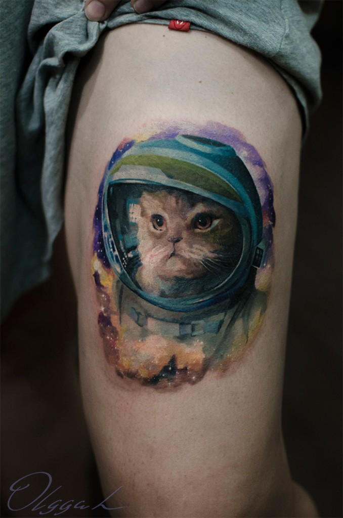 Illustrative style colored arm tattoo of cat astronaut