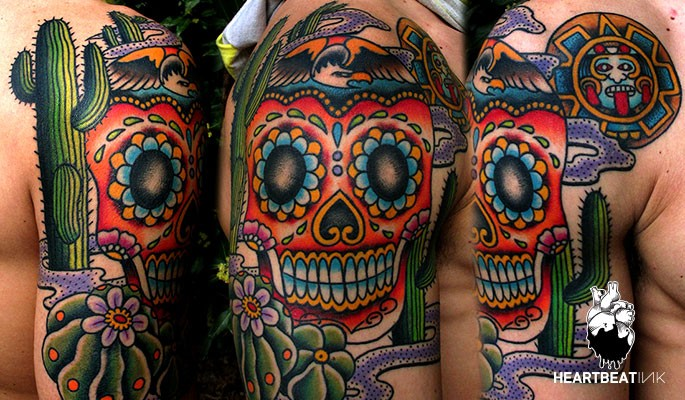 Illustrative style colored shoulder tattoo of Mexican skull and cactus