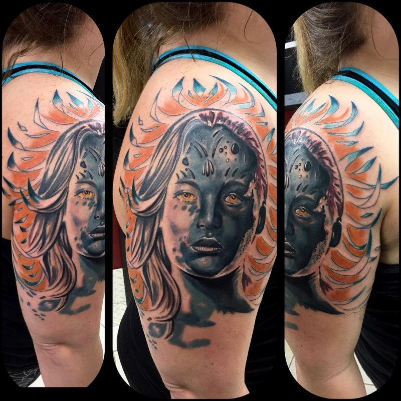 Illustrative style colored shoulder tattoo of woman face with symbols