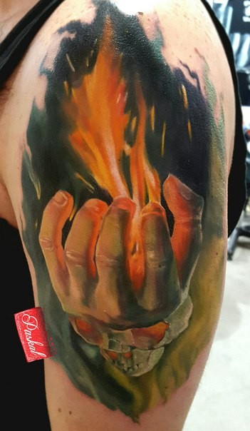 Illustrative style colored shoulder tattoo of man with burning hand