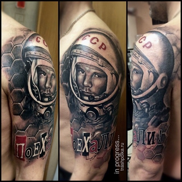 New school style colored shoulder tattoo of famous astronaut with lettering