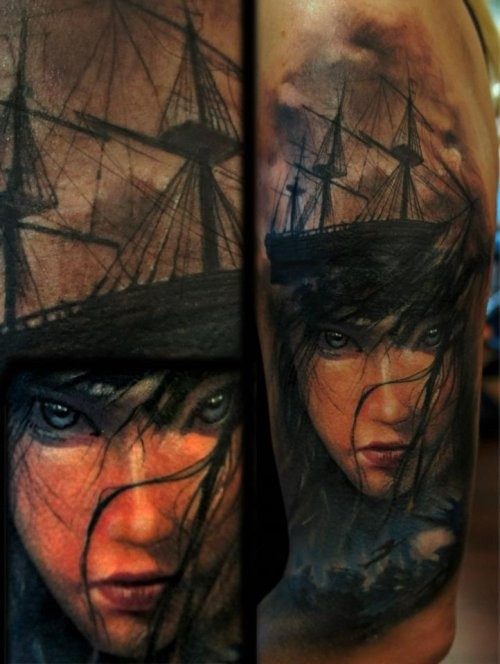Illustrative style colored shoulder tattoo of woman face with ship