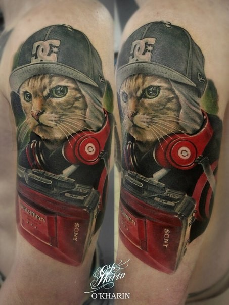 New school style colored shoulder tattoo of cool cat with hat and headset