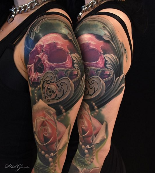 Illustrative style colored shoulder tattoo of red skull with rose and jewelry