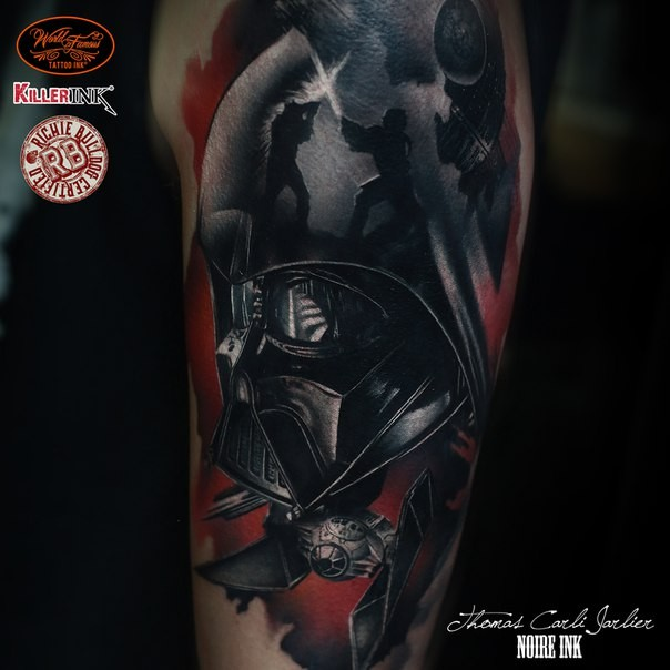 Illustrative style colored shoulder tattoo of Darth Vader&quots helmet with space ship
