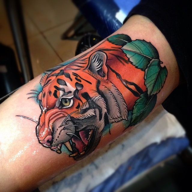 New school style colored arm tattoo of big tiger head