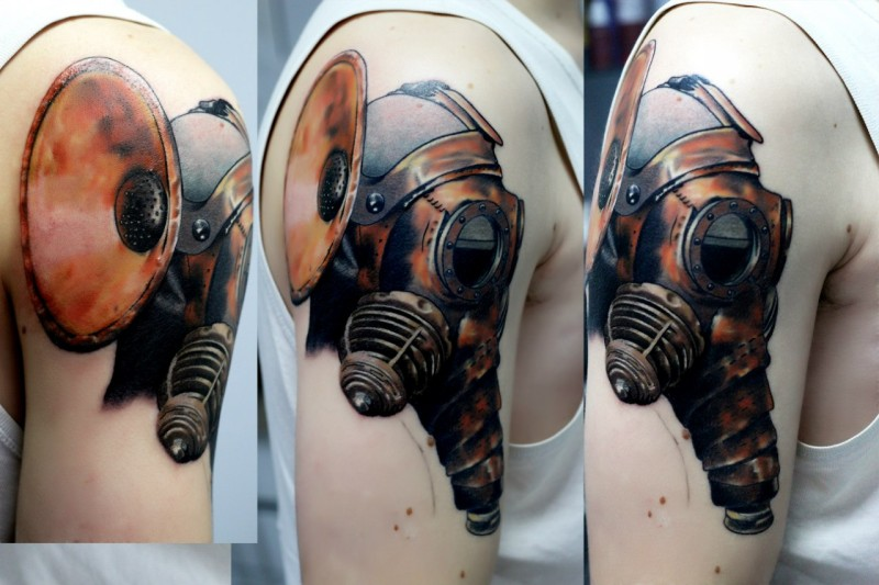 New school style colored shoulder tattoo of mechanical gas mask