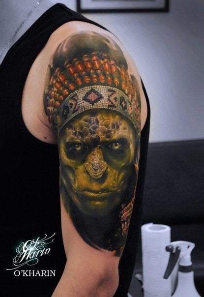 Illustrative style colored shoulder tattoo of creepy Indian zombie chief