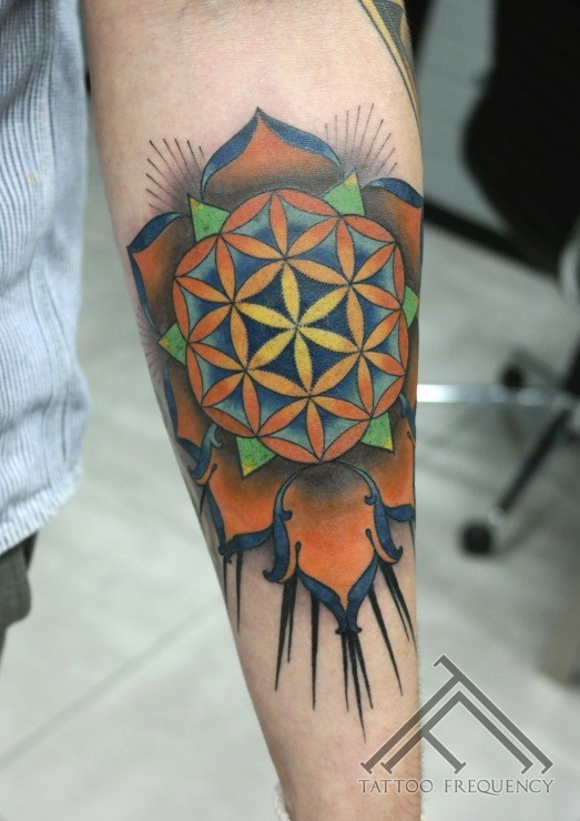 New school style colored forearm tattoo of big flower