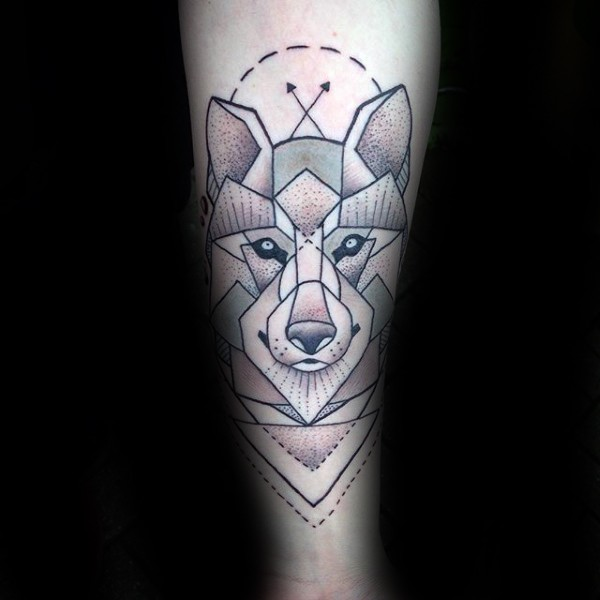 Illustrative style colored arm tattoo of wolf head with crossed arrows